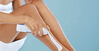 Buy stock photo Cropped shot of an unrecognizable woman applying shaving foam to her legs