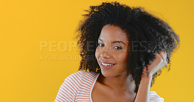 Buy stock photo Cropped shot of a beautiful young woman posing against a yellow background