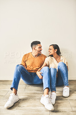 Buy stock photo Shot of a happy young couple bonding in their new home