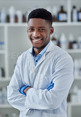 Buy stock photo Portrait of a cheerful young male scientist standing with arms folded inside of a laboratory