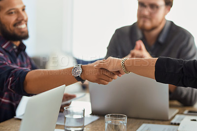 Buy stock photo Closeup shot of two businesspeople shaking hands in an office