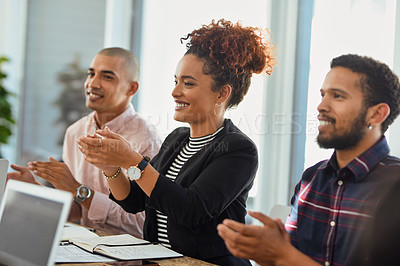 Buy stock photo Shot of a group of businesspeople applauding during a presentation in an office