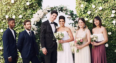 Buy stock photo Cropped portrait of an affectionate young newlywed couple standing with their groomsmen and bridesmaids on their wedding day