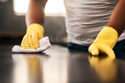 Buy stock photo Cropped shot of an unrecognizable man cleaning a kitchen counter at home