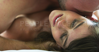 Buy stock photo Cropped shot of an affectionate young couple being intimate in their bedroom