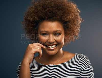 Buy stock photo Studio portrait of an attractive young woman smiling while standing against a grey background