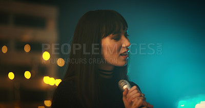 Buy stock photo Shot of a young woman singing on stage