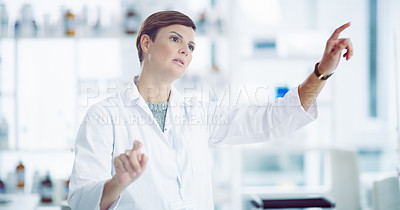 Buy stock photo Shot of a scientist connection to a user interface in a lab