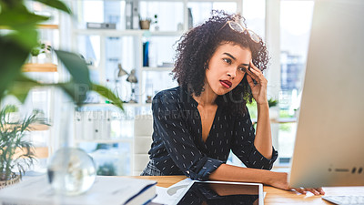 Buy stock photo Cropped shot of an attractive young businesswoman sitting in her office and using a computer while suffering from a headache