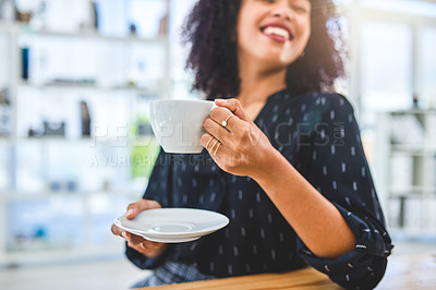 Buy stock photo Cropped shot of an attractive young businesswoman sitting alone in the office and enjoying a cup of tea