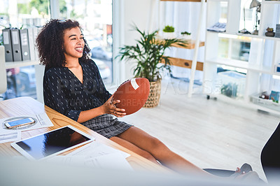 Buy stock photo Cropped shot of an attractive young businesswoman sitting in her office and playing with a ball while taking a break