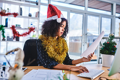Buy stock photo Cropped shot of an attractive young businesswoman sitting and wearing christmas decorations while working on her computer in the office