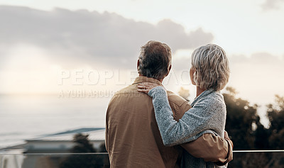 Buy stock photo Rearview shot of an unrecognizable mature couple embracing each other while celebrating a new year outdoors