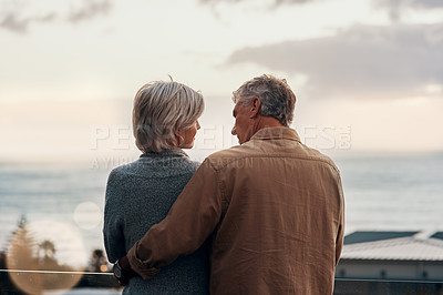 Buy stock photo Rearview shot of an affectionate  mature couple embracing each other while celebrating a new year outdoors