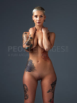 Buy stock photo Cropped portrait of a beautiful young woman posing nude in the studio