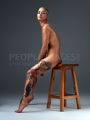 Buy stock photo Full length portrait of a beautiful young woman posing nude on a stool in the studio