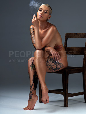 Buy stock photo Full length portrait of a beautiful young woman posing nude on a chair in the studio