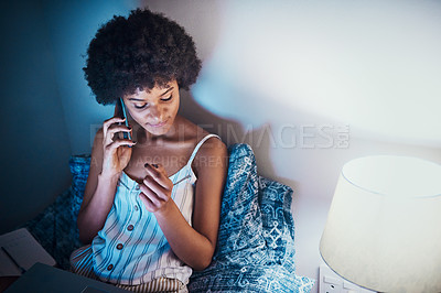 Buy stock photo Cropped shot of an attractive young woman sitting on her bed at home and using a cellphone at night
