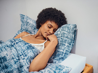 Buy stock photo Cropped shot of an attractive young woman lying in her bed alone at home and sleeping