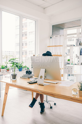 Buy stock photo Shot of an unrecognizable woman sitting at her desk