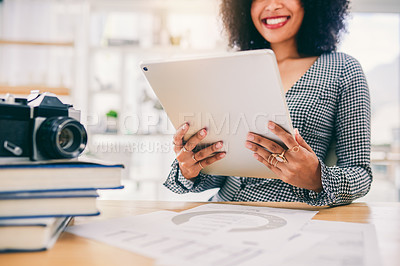 Buy stock photo Cropped shot of an unrecognizable woman using a digital tablet at her desk