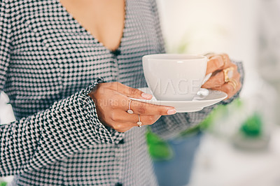 Buy stock photo Cropped shot of an unrecognizable woman holding a cup of coffee