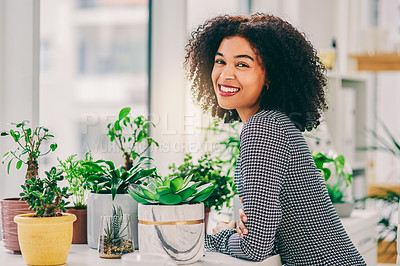 Buy stock photo Cropped shot of an attractive young business owner surrounded by plants