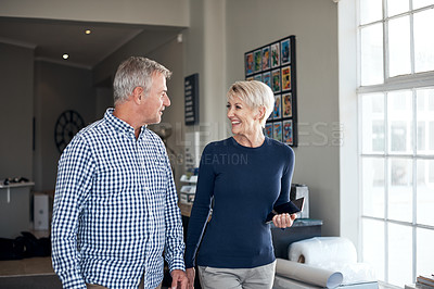 Buy stock photo Shot of two businesspeople having a discussion while walking together in an office