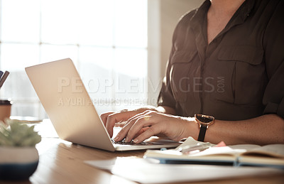 Buy stock photo Cropped shot of an unrecognizable businesswoman using a laptop at her desk