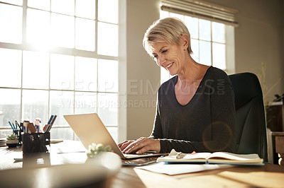 Buy stock photo Cropped shot of a businesswoman using a laptop at her desk