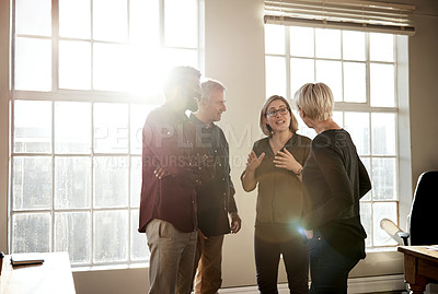 Buy stock photo Shot of a group of creative businesspeople having a discussion at the office