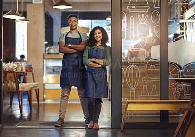Buy stock photo Portrait of a young man and woman working together in a cafe