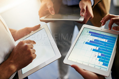 Buy stock photo Cropped shot of unrecognizable businesspeople using their digital tablets
