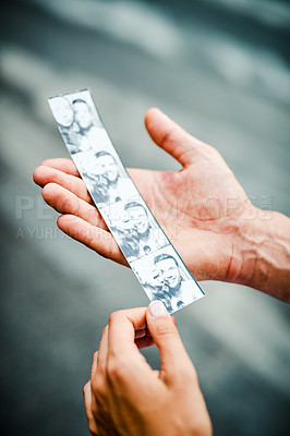 Buy stock photo Cropped shot of an unrecognizable couple holding their photobooth strip