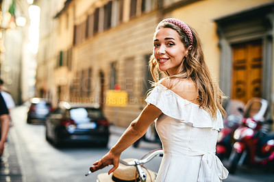 Buy stock photo Cropped shot of young woman out cycling through the city of Florence