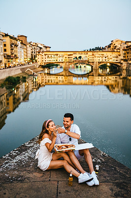 Buy stock photo Shot of an affectionate couple out on a romantic date in a foreign city