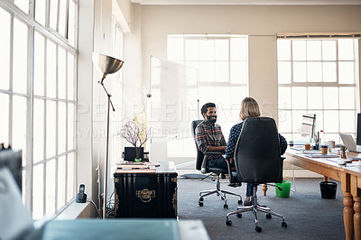 Buy stock photo Cropped shot of two mature businesspeople sitting in the office together and having a discussion