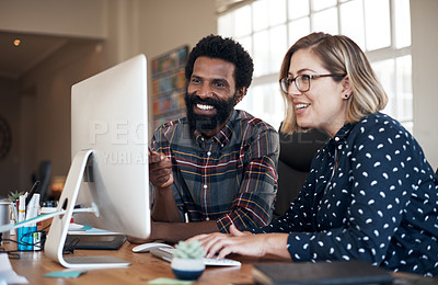 Buy stock photo Cropped shot of two mature businesspeople sitting in the office together and using a computer