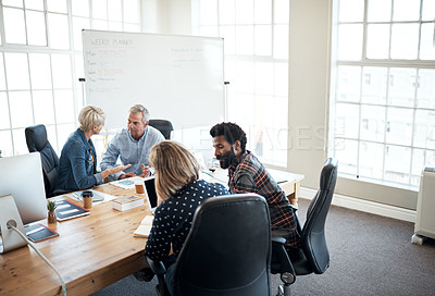 Buy stock photo Cropped shot of a diverse group of businesspeople sitting together and having a discussion in the office