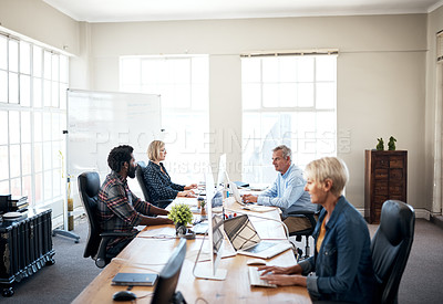 Buy stock photo Cropped shot of a diverse group of creative businesspeople working in their office