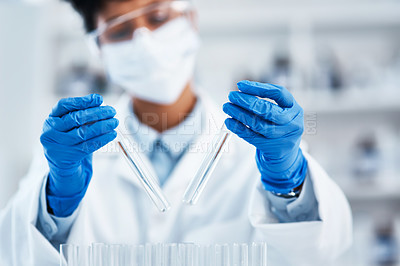 Buy stock photo Closeup shot of a young scientist working with samples in a lab