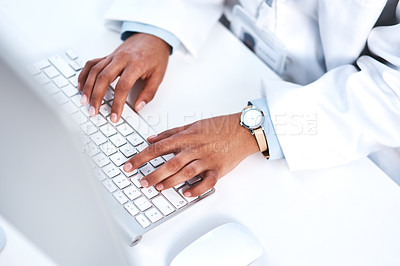 Buy stock photo High angle shot of an unrecognisable scientist working on a computer in a lab