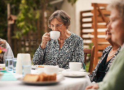 Buy stock photo Cropped shot of a senior woman sitting with her friends and enjoying a cup of tea during a tea party