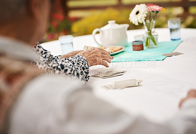 Buy stock photo Cropped shot of an unrecognizable woman sitting and dishing out a deck of cards during a game of bridge
