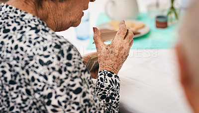 Buy stock photo Cropped shot of an unrecognizable woman sitting and shuffling a deck of cards before playing a game of bridge