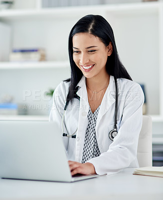 Buy stock photo Shot of a young doctor using a laptop at her desk