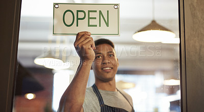 Buy stock photo Shot of a young man holding an