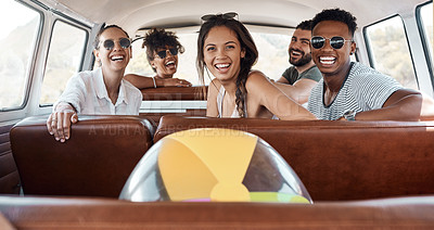 Buy stock photo Shot of a group of happy young friends going on a road trip together