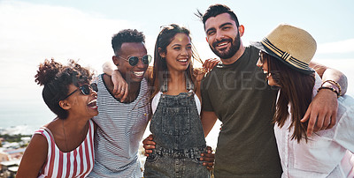 Buy stock photo Shot of a group of friends standing together while spending the day outdoors