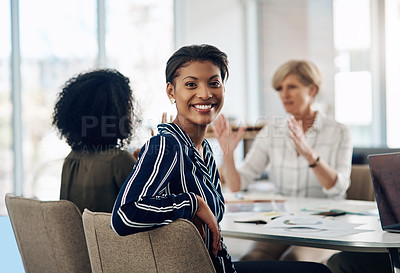 Buy stock photo Cropped portrait of an attractive young businesswoman smiling while sitting in a meeting in a modern office